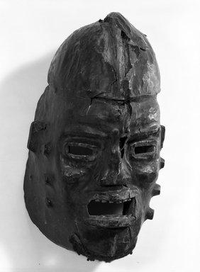 Widekum. <em>Nchibe Skin-covered Domed Face Mask</em>, early 20th century. Animal skin, wood, hair, metal, 14 3/4 x 9 x 8 in. (37.5 x 22.8 x 20.3 cm). Brooklyn Museum, Gift of Gaston T. de Havenon, 73.179.7. Creative Commons-BY (Photo: Brooklyn Museum, 73.179.7_bw.jpg)