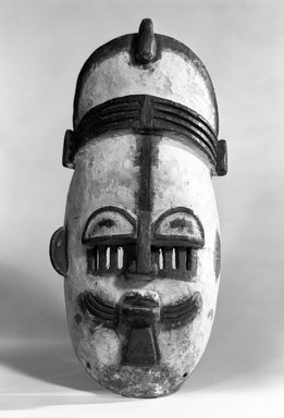 Edo. <em>Ekpo Face Mask of a Chief</em>, late 19th or early 20th century. Wood, pigment, metal, 14 1/4 x 7 1/4 x 4 1/2 in. (36.3 x 18.3 x 11.5 cm). Brooklyn Museum, Gift of Gaston T. de Havenon, 73.179.9. Creative Commons-BY (Photo: Brooklyn Museum, 73.179.9_bw.jpg)