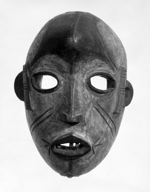 Idoma. <em>Mask of Face with Void Eyes</em>, early 20th century. Wood, wire, teeth, pigment, 8 1/4 x 6 x 4 1/2 in. (21.0 x 15.1 x 11.5 cm). Brooklyn Museum, Gift of Ruth R. Gross, 73.180.3. Creative Commons-BY (Photo: Brooklyn Museum, 73.180.3_bw.jpg)