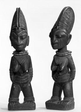 Yorùbá artist. <em>Female twin figure (Ère Ìbejì)</em>, late 19th or early 20th century. Beads, wood, pigment, h: 11 1/2 in. (29.2 cm). Brooklyn Museum, Gift of Ruth R. Gross, 73.180.6. Creative Commons-BY (Photo: , 73.180.6_73.180.7_bw.jpg)