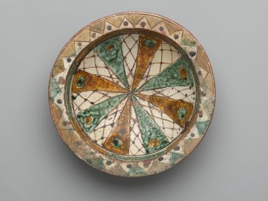<em>Bowl with Incised Decoration</em>, 12th-13th century. Ceramic, sgraffiato (incised) ware; earthenware, incised and painted with manganese purple, ochre, and green under a transparent glaze, Foot: 5/8 x 3 in. (1.6 x 7.6 cm). Brooklyn Museum, Gift of The Roebling Society, 73.30.1. Creative Commons-BY (Photo: Brooklyn Museum, 73.30.1_top_PS2.jpg)