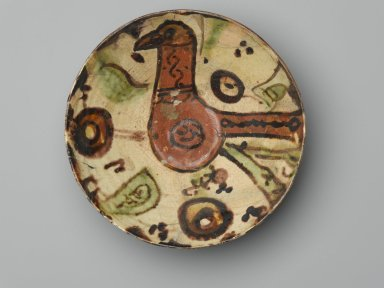 <em>Bowl with a Bird</em>, 10th-11th century. Ceramic, Sari ware; earthenware, painted in red, brown, and green slip on a white slip ground under a transparent glaze, 3/8 x 2 7/8 in. (1 x 7.3 cm). Brooklyn Museum, Gift of The Roebling Society, 73.30.2. Creative Commons-BY (Photo: Brooklyn Museum, 73.30.2_top_PS2.jpg)