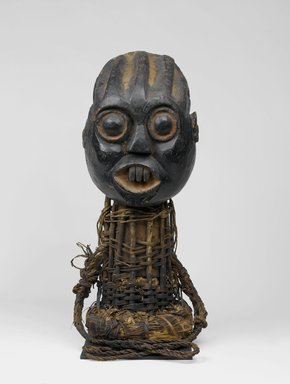 Bamum. <em>Funerary Headdress (Tugunga)</em>, late 19th century. Wood, rattan, pigment, 33 x 14 3/16 x 14 3/16 in. (83.8 x 36 x 36 cm). Brooklyn Museum, Gift of Mrs. Melville W. Hall, 73.36. Creative Commons-BY (Photo: Brooklyn Museum, 73.36_front_PS1.jpg)