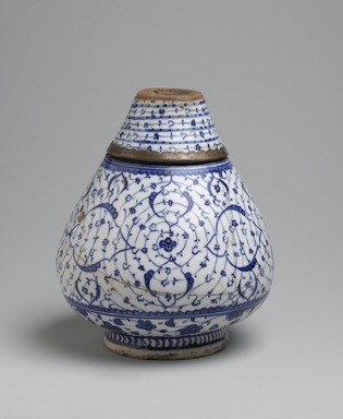 "<em>Flask in Two Sections with ""Golden Horn"" or Tugrakes Motif</em>, first half 16th century. Ceramic; fritware, painted in cobalt blue under a transparent glaze; 19th-century brass mount, 12 1/4 × 6 1/2 in. (31.1 × 16.5 cm). Brooklyn Museum, Special Middle Eastern Art Fund, 73.66.3a-c. Creative Commons-BY (Photo: Brooklyn Museum, 73.66.3a-c_PS2.jpg)"