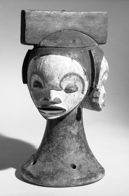 Idoma. <em>Headdress with Multiple Faces</em>, early 20th century. Wood, pigment, 11 1/4  x 6 1/4 in. (28.5 x 16.0 cm). Brooklyn Museum, Gift of Mr. and Mrs. Joseph Gerofsky, 73.9.2. Creative Commons-BY (Photo: Brooklyn Museum, 73.9.2_bw.jpg)