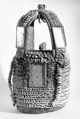 Yorùbá. <em>House of the Head (Ile Ori)</em>, early 20th century. Cowrie shells, wood, leather, fiber, mirrors, 16in. (40.6cm). Brooklyn Museum, Gift of Mr. and Mrs. Joseph Gerofsky, 73.9.3. Creative Commons-BY (Photo: Brooklyn Museum, 73.9.3_bw.jpg)