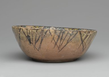 <em>Bowl with Blessings</em>, 10th century. Ceramic; earthenware, painted in black slip and green and yellow pigments under a transparent glaze, 2 13/16 x 7 1/2 in. (7.1 x 19.1 cm). Brooklyn Museum, Gift of Mr. and Mrs. Charles K. Wilkinson, 73.94.3. Creative Commons-BY (Photo: Brooklyn Museum, 73.94.3_side1_PS2.jpg)