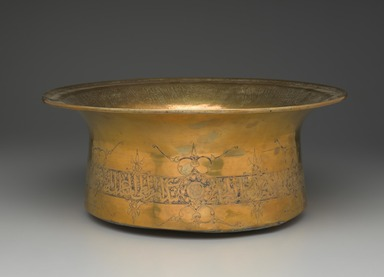 <em>Basin Inscribed with Honorifics in Arabic Thuluth Script</em>, mid 14th century. Brass, incised, punched, and inlaid with silver, 7 1/16 x 16 15/16 in. (18 x 43 cm). Brooklyn Museum, Gift of Mr. and Mrs. Charles K. Wilkinson, 73.94.4. Creative Commons-BY (Photo: Brooklyn Museum, 73.94.4_PS2.jpg)
