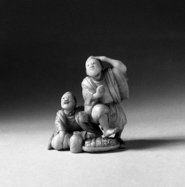 Minko. <em>Netsuke Depicting Two Men Drinking Sake</em>, 19th century. Ivory, 1 1/2in. (3.8cm). Brooklyn Museum, Gift of Mr. and Mrs. Burton Krouner, 74.103.11. Creative Commons-BY (Photo: Brooklyn Museum, 74.103.11_view1_bw.jpg)