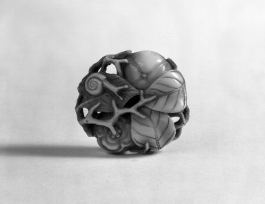 <em>Netsuke Depicting Two Persimmons and a Snail</em>, 19th century. Ivory, 1/2 x 1 1/2 in. (1.3 x 3.8 cm). Brooklyn Museum, Gift of Mr. and Mrs. Burton Krouner, 74.103.9. Creative Commons-BY (Photo: Brooklyn Museum, 74.103.9_view1_bw.jpg)