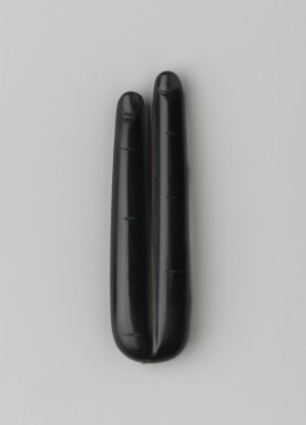 <em>Two Fingers Amulet</em>, 332-30 B.C.E. Obsidian, 3/8 x 7/8 x 3 1/4 in. (1 x 2.2 x 8.3 cm). Brooklyn Museum, Charles Edwin Wilbour Fund, 74.158. Creative Commons-BY (Photo: Brooklyn Museum, 74.158_front_PS2.jpg)