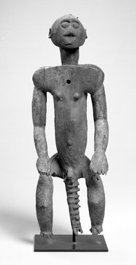 Montol. <em>Standing Male Figure</em>, early 20th century. Wood, 17 1/4 x 6 x 5 in. (43.8 x 15.3 x 12.7 cm). Brooklyn Museum, Gift of Dr. and Mrs. Ernst Anspach, 74.171.1. Creative Commons-BY (Photo: Brooklyn Museum, 74.171.1_front_bw.jpg)
