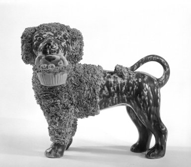 <em>Figure of a Poodle, One of Pair</em>, ca. 1849-1858. Glazed stoneware, 8 1/4 x 9 3/4 in.  (21.0 x 24.8 cm). Brooklyn Museum, H. Randolph Lever Fund, 74.19.3. Creative Commons-BY (Photo: Brooklyn Museum, 74.19.3_bw.jpg)