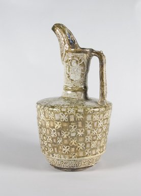 <em>Ewer</em>, early 13th century. Ceramic; fritware, painted in golden brown luster and blue glaze over an opaque white glaze, 14 3/8 x 7 3/4 in. (36.5 x 19.7 cm). Brooklyn Museum, Gift of Mr. and Mrs. Paul E. Manheim, 74.196. Creative Commons-BY (Photo: Brooklyn Museum, 74.196_PS5.jpg)