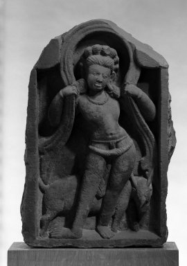 <em>Vayu with His Deer, Guardian of the Northwest</em>, 7th-9th century. Sandstone, 17 x 11 1/4 in. (43.2 x 28.6 cm). Brooklyn Museum, Gift of Emily Goldman, 74.198.2. Creative Commons-BY (Photo: Brooklyn Museum, 74.198.2_bw_IMLS.jpg)