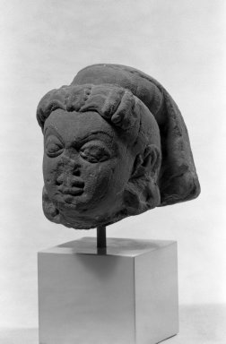 <em>Head of a Goddess with High Headdress</em>, ca. 2nd century. Red sikri sandstone, 4 1/2 x 4 in. (11.4 x 10.2 cm). Brooklyn Museum, Gift of Martha M. Green, 74.199.1. Creative Commons-BY (Photo: Brooklyn Museum, 74.199.1_bw.jpg)