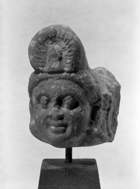 <em>Small Head of a Deity or Attendant</em>, ca. 2nd century. Red sikri sandstone, 6 1/2 x 4 1/2 in. (16.5 x 11.4 cm). Brooklyn Museum, Gift of Martha M. Green, 74.199.2. Creative Commons-BY (Photo: Brooklyn Museum, 74.199.2_bw.jpg)