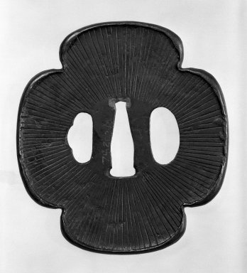 <em>Tsuba (Sword Guard)</em>, 18th century (possibly). Black-patinated iron, copper, 3 9/16 x 3 5/16 in. (9 x 8.4 cm). Brooklyn Museum, Gift of Leighton R. Longhi, 74.202.10. Creative Commons-BY (Photo: Brooklyn Museum, 74.202.10_side1_bw.jpg)