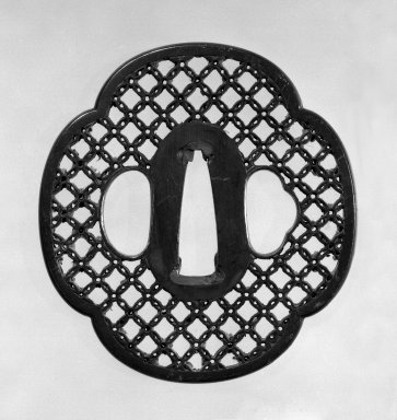 <em>Tsuba (Sword Guard)</em>, 18th century (possibly). Shibuichi, gold, copper, 2 7/8 x 2 11/16 in. (7.3 x 6.8 cm). Brooklyn Museum, Gift of Leighton R. Longhi, 74.202.22. Creative Commons-BY (Photo: Brooklyn Museum, 74.202.22_front_bw.jpg)