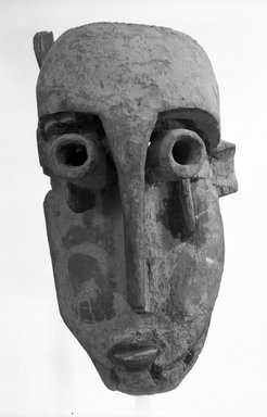 Fang. <em>Mask with Asymmetrical Face (Ekekek)</em>, late 19th-early 20th century. Wood, 22 1/2 x 9 1/2 x 11 1/2 in. (57.2 x 24.1 x 29.4 cm). Brooklyn Museum, Gift of Mr. and Mrs. Gordon Douglas, 74.211.1. Creative Commons-BY (Photo: Brooklyn Museum, 74.211.1_bw.jpg)