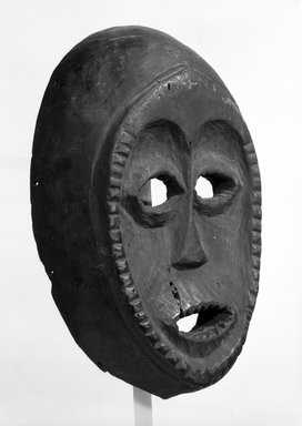Igala. <em>Ovoid-Shaped Face Mask</em>, early 20th century. Dark wood, 10 3/4 x 6 5/8 x 3 1/4 in. (27.3 x 16.8 x 8.2 cm). Brooklyn Museum, Gift of Mr. and Mrs. J. Gordon Douglas III, 74.211.5. Creative Commons-BY (Photo: Brooklyn Museum, 74.211.5_bw.jpg)