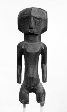 Buyu. <em>Standing Male Figure</em>, late 19th or early 20th century. Wood, 22 1/2 x 6 3/4 x 8in. (57.2 x 17.1 x 20.3cm). Brooklyn Museum, Gift of Mr. and Mrs. Gordon Douglas, 74.211.8. Creative Commons-BY (Photo: Brooklyn Museum, 74.211.8_bw.jpg)
