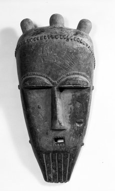 Baule. <em>Portrait Mask (ndoma)</em>, late 19th or early 20th century. Wood, pigment, length: 16 in. (41.0 cm). Brooklyn Museum, Purchased with funds given by the Evelyn A. J. Hall Charitable Trust, 74.212.1. Creative Commons-BY (Photo: Brooklyn Museum, 74.212.1_bw.jpg)
