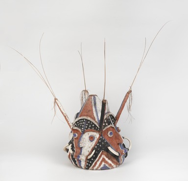Tomman Islander. <em>Headdress (Nalowan Nambatin avi)</em>, mid 20th century. Tree fern, vegetal-fiber paste, tusks, pigment, 30 × 32 11/16 × 30 11/16 in. (76.2 × 83 × 78 cm) [measurements include fiber]. Brooklyn Museum, Gift of Mr. and Mrs. N. Richard Miller, 74.215.4. Creative Commons-BY (Photo: , 74.215.4_threequarter_PS9.jpg)