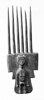 Attie. <em>Comb</em>, late 19th-early 20th century. Wood, 7 7/8 x 2 11/16 in. (20 x 6.8 cm). Brooklyn Museum, Gift of Dr. and Mrs. Willi Riese to the Jennie Simpson Educational Collection of African Art, 74.217.2. Creative Commons-BY (Photo: Brooklyn Museum, 74.217.2_bw.jpg)
