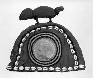 Baule. <em>Hat</em>, mid-20th century. Red twill over leather, cowrie shells, yarn, 8 3/4 x 10 1/8 in. (22.2 x 25.7 cm). Brooklyn Museum, Gift of Dr. and Mrs. Willi Riese to the Jennie Simpson Educational Collection of African Art, 74.217.4. Creative Commons-BY (Photo: Brooklyn Museum, 74.217.4_bw.jpg)
