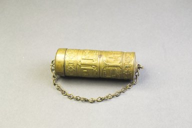 Asante. <em>Cylindrical Container</em>. Copper alloy, Diam.: 1 x  L. without chain: 3 3/8 in. (2.5 x 8.6 cm). Brooklyn Museum, The Franklin H. Williams Collection of Ashanti Brass Weights and Accessory Objects for Weighing Gold, Gift of Mrs. and Mrs. Franklin H. Williams, 74.218.120. Creative Commons-BY (Photo: Brooklyn Museum, 74.218.120_PS5.jpg)