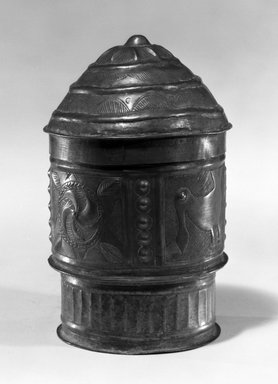 Asante. <em>Cylindrical Container with Lid  (Forowa)</em>, late 19th-early 20th century. Beaten sheet brass, 6 7/8 x 4 1/16 x 4 1/16 (17.5 x 10.3 x 10.3 cm). Brooklyn Museum, The Franklin H. Williams Collection of Ashanti Brass Weights and Accessory Objects for Weighing Gold, Gift of Mrs. and Mrs. Franklin H. Williams, 74.218.121a-b. Creative Commons-BY (Photo: Brooklyn Museum, 74.218.121a-b_bw.jpg)