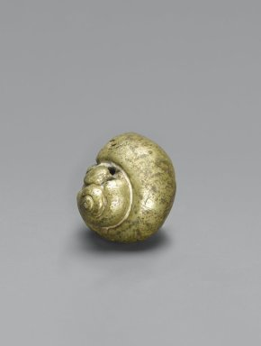 Asante. <em>Gold-weight (abrammuo): snail</em>, 19th or 20th century. Cast brass, 11/16 x 3/4 x 7/8 in. (1.7 x 1.9 x 2.2 cm). Brooklyn Museum, The Franklin H. Williams Collection of Ashanti Brass Weights and Accessory Objects for Weighing Gold, Gift of Mr. and Mrs. Franklin H. Williams, 74.218.85. Creative Commons-BY (Photo: Brooklyn Museum, 74.218.85_PS6.jpg)