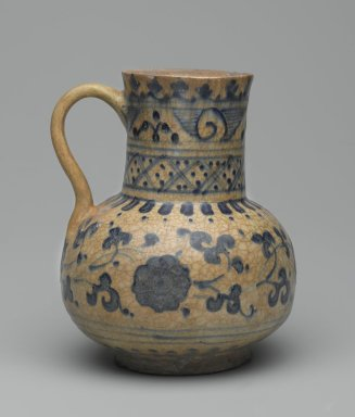 <em>Jug</em>, first half 15th century. Ceramic; fritware, painted in cobalt blue on an opaque white glaze, 5 7/8 x 4 3/4 in. (15 x 12 cm). Brooklyn Museum, Gift of the Governing Committee in honor of Elizabeth Riefstahl, 74.24. Creative Commons-BY (Photo: Brooklyn Museum, 74.24_side1_PS2.jpg)