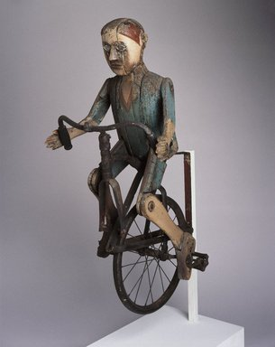 Lewis Simon (American, 1884-1970). <em>Trade Sign (Boy Riding Bicycle)</em>, 1932-1934. Painted wood, metal, rubber, other materials, 40 1/2 x 18 x 23 in.  (102.9 x 45.7 x 58.4 cm). Brooklyn Museum, H. Randolph Lever Fund and Dick S. Ramsay Fund, 74.29. Creative Commons-BY (Photo: Brooklyn Museum, 74.29_SL1.jpg)