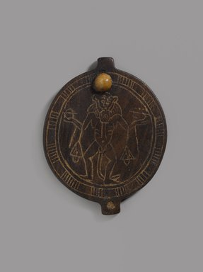 <em>Lid of Circular Cosmetic Container with Birth God</em>, ca. 1479-1400 B.C.E. Wood, ivory, paste (?), 3 1/8 x 2 1/2 x 3/16 in. (7.9 x 6.3 x 0.5 cm). Brooklyn Museum, Charles Edwin Wilbour Fund, 74.45. Creative Commons-BY (Photo: Brooklyn Museum, 74.45_PS9.jpg)