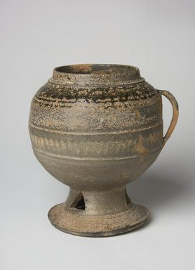 <em>Pedestal Jar</em>, 5th century. Stoneware with ash glaze, Height: 7 1/16 in. (18 cm). Brooklyn Museum, Gift of Nathan Hammer, 74.61.8. Creative Commons-BY (Photo: Brooklyn Museum, 74.61.8_PS11.jpg)