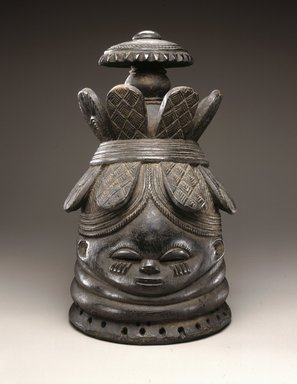 Mende. <em>Sande society mask (sowei)</em>, late 19th-early 20th century. Wood, pigment, metal, 15 1/2 x 9 1/4 x 10 1/4 in. (39.4 x 23.5 x 26 cm). Brooklyn Museum, Carll H. de Silver Fund, 74.64. Creative Commons-BY (Photo: Brooklyn Museum, 74.64_edited_version_SL1.jpg)