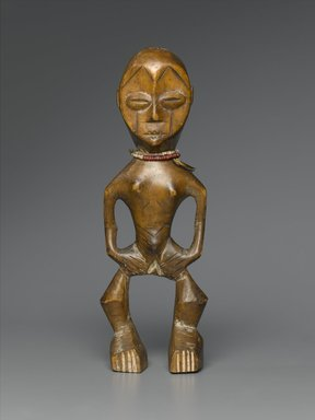 Lega. <em>Figure (Iginga)</em>, late 19th or early 20th century. Wood, plastic beads, 11 x 3 3/4 x 2 1/2 in. (27.9 x 9.5 x 6.4 cm). Brooklyn Museum, Gift of Marcia and John Friede, 74.66.1. Creative Commons-BY (Photo: Brooklyn Museum, 74.66.1_PS2.jpg)