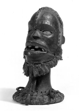 Ejagham. <em>Skin-covered Headdress with Raffia Beard</em>, late 19th or early 20th century. Wood, antelope skin, fiber, pigment, metal, 13 1/2 x 8 in. (34.3 x 20.3 cm). Brooklyn Museum, Gift of Mr. and Mrs. John A. Friede, 74.66.2. Creative Commons-BY (Photo: Brooklyn Museum, 74.66.2_bw.jpg)