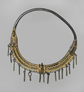 Dogon. <em>Necklace</em>, 11th-15th century (?). Copper alloy, 9 x 9 x 1 in. (22.9 x 22.9 x 2.5 cm). Brooklyn Museum, Gift of Mrs. Jacob M. Kaplan, 74.67. Creative Commons-BY (Photo: Brooklyn Museum, 74.67_PS2.jpg)