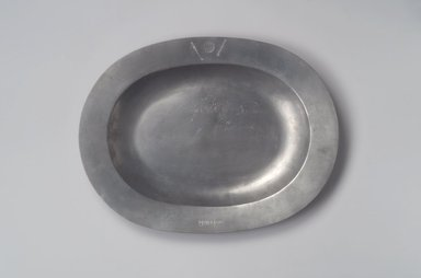 Jay Thomas Stauffer (after original by Henry Will). <em>Platter, After Henry Will</em>, 1974 (after original of 1761-1793). Pewter, 1 1/4 x 15 1/4 x 11 5/8 in. (3.2 x 38.7 x 29.5 cm). Brooklyn Museum, Gift of Jay Thomas Stauffer, 74.77. Creative Commons-BY (Photo: Brooklyn Museum, 74.77.jpg)