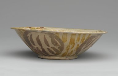 <em>Bowl with Abstract Foliate Design</em>, 9th century. Ceramic; earthenware, painted in luster on an opaque white glaze, 2 1/8 x 7 1/8 x 7 1/8 in. (5.4 x 18.1 x 18.1 cm). Brooklyn Museum, Gift of Mr. and Mrs. Carl L. Selden, 74.78. Creative Commons-BY (Photo: Brooklyn Museum, 74.78_side1_PS2.jpg)