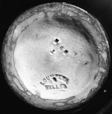 Weller Pottery (1872-1949). <em>Ewer</em>, 1895-1918. Earthenware with underglaze decoration, 13 3/4 x 3 3/8 in. (34.9 x 8.6 cm). Brooklyn Museum, Gift of John H. Livingston, 74.96.4. Creative Commons-BY (Photo: Brooklyn Museum, 74.96.4_mark_bw.jpg)