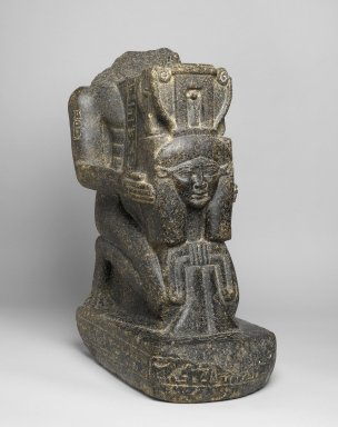 <em>Kaemwaset Kneeling with an Emblem of Hathor</em>, ca. 1400-1390 B.C.E. Granite, pigment, 26 1/8 x 10 1/4 x 17 13/16in. (66.3 x 26 x 45.3cm). Brooklyn Museum, Gift of Christos G. Bastis, 74.97. Creative Commons-BY (Photo: Brooklyn Museum, 74.97_threequarter_right_PS1.jpg)