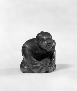 <em>Netsuke, Seated Male Figure</em>, 18th century. Wood, 1 1/2 x 1 3/8 in. (3.8 x 3.5 cm). Brooklyn Museum, Gift of Mr. and Mrs. Tessim Zorach, 75.10.2. Creative Commons-BY (Photo: Brooklyn Museum, 75.10.2_bw.jpg)