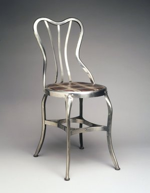 "Clement Uhl (American, 1878-1964). <em>""Perfection"" Chair, model 151</em>, 1903. Steel (possibly nickel plated), wood, plastic, Overall Height:  34 1/2 in.  (87.6 cm); . Brooklyn Museum, Gift of Mr. and Mrs. Jonathan Holstein, 75.108. Creative Commons-BY (Photo: Brooklyn Museum, 75.108_transp3721.jpg)"