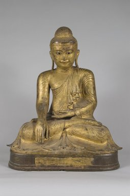 <em>Seated Shakyamuni Buddha</em>, late 19th-early 20th century. Gilt bronze, 23 x 18 1/2 x 13 1/2 in. (58.4 x 47 x 34.3 cm). Brooklyn Museum, Designated Purchase Fund, 75.11.1. Creative Commons-BY (Photo: Brooklyn Museum, 75.11.1_PS5.jpg)