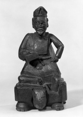 <em>Folk Sculpture (A Man Seated On a Chess Board)</em>, 18th century. Wood, 7 7/8 x 4 in. (20 x 10.2 cm). Brooklyn Museum, Gift of Beatrice and Jeanette Rothbard, 75.122.1. Creative Commons-BY (Photo: Brooklyn Museum, 75.122.1_bw.jpg)