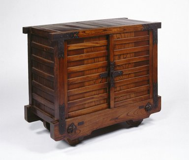 <em>Kuruma-Dansu (Chest of Drawers)</em>, late 19th-early 20th century. Zelkova (keyaki) and cryptomeria (sugi) wood with iron fittings, 37 1/8 x 44 1/8 x 21 3/8 in.  (94.3 x 112.1 x 54.3 cm). Brooklyn Museum, Designated Purchase Fund, 75.126. Creative Commons-BY (Photo: Brooklyn Museum, 75.126_SL1.jpg)